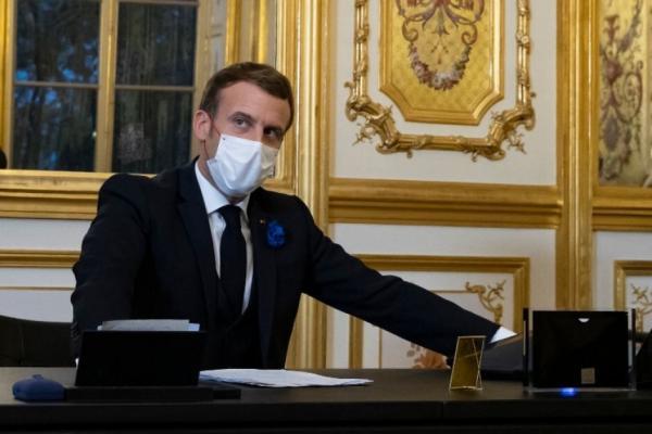 خبرنگاران مکرون از بازگشت آمریکا به توافق پاریس استقبال کرد